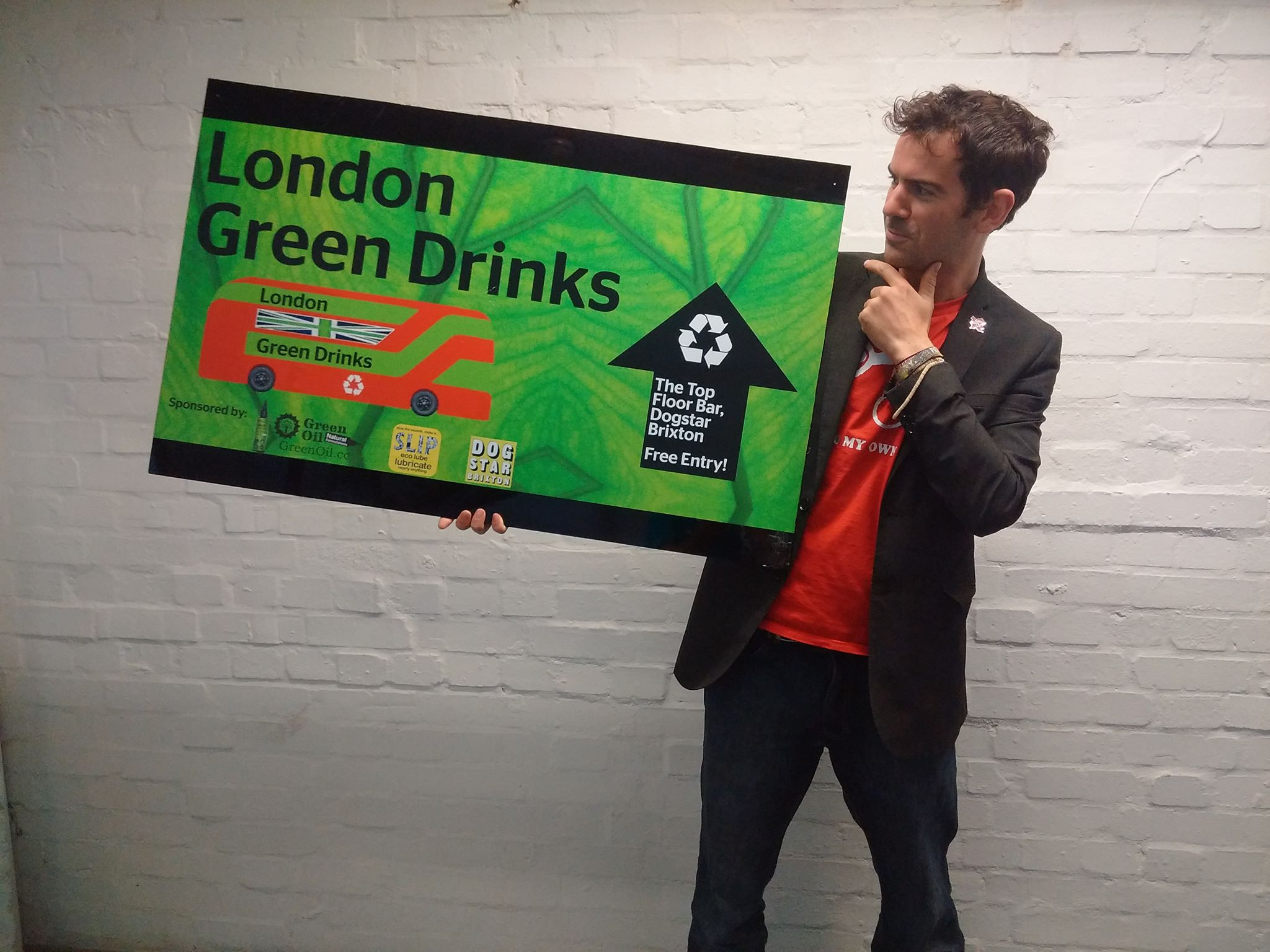 Simon Nash holding a the London Green Drinks sign